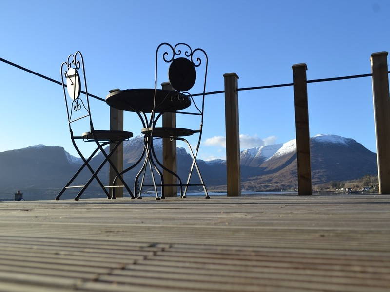 deck area and views over the snow capped applecross hills